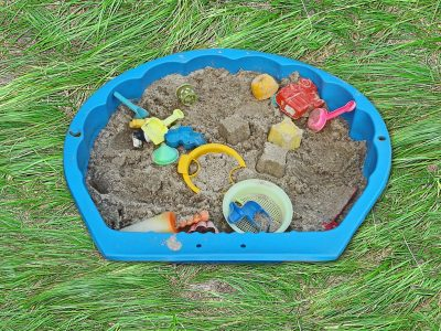 Sandpit with children's toys
